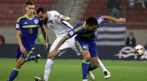 "epa05630381 Greece's Kostas Mitroglou (L) vies for the ball with Bosnia and Herzegovina' Emir Spahic (R) during qualifying Round 1 Group H Matchday 4 soccer match for the FIFA 2018 World Cup, Greece vs. Bosnia and Herzegovina, held at the ""Karaiskaki"" Stadium in Athens, Greece, 13 November 2016.  EPA/PANAGIOTIS MOSCHANDREOU"