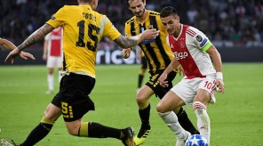 Soccer Football - Champions League - Group Stage - Group E - Ajax Amsterdam v AEK Athens - Johan Cruijff Arena, Amsterdam, Netherlands - September 19, 2018  AEK Athens' Uros Cosic and Marios Oikonomou in action with Ajax's Dusan Tadic   REUTERS/Piroschka Van De Wouw